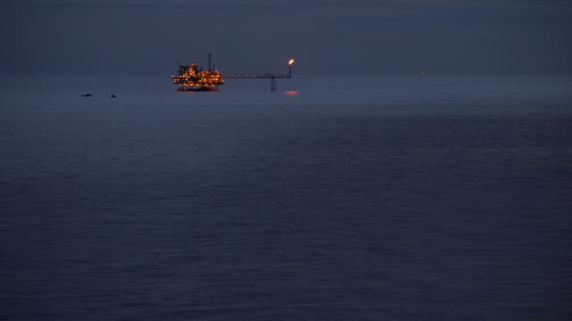 oil production platform in the ocean night time