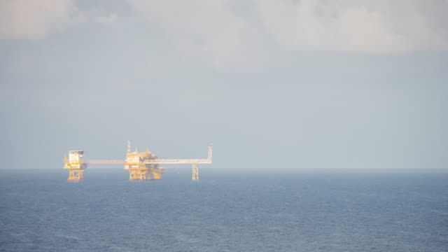 oil production platform time lapse day time - oil rig stock videos and b-roll footage