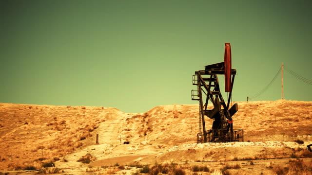 oil pump in the desert - hd loop - in the loop 2009 film stock videos and b-roll footage