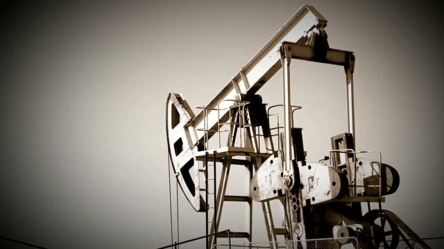 oil pump, industry equipment in a rape chain. oil production - making money stock videos & royalty-free footage