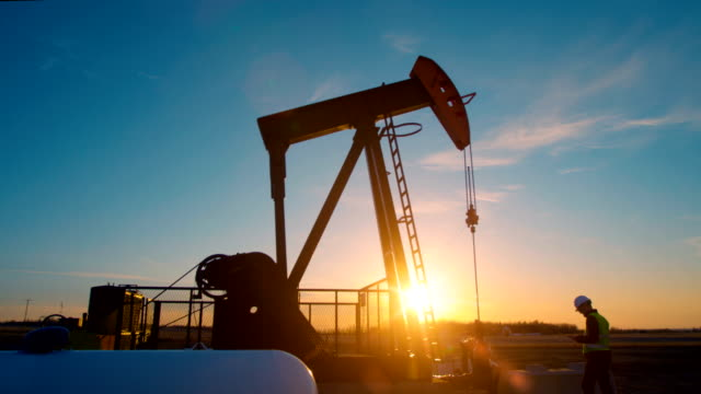 oil pump jack pumps oil from the ground. - pump jack stock videos & royalty-free footage