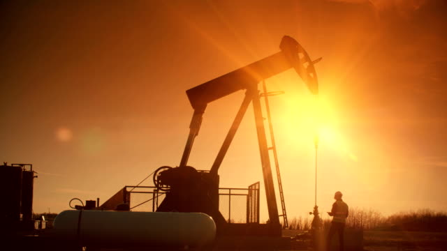 oil pump jack pumps oil from the ground. - mining stock videos & royalty-free footage