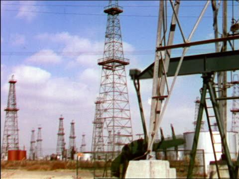 1949 oil pump moving in oil field / industrial - pump jack stock videos & royalty-free footage
