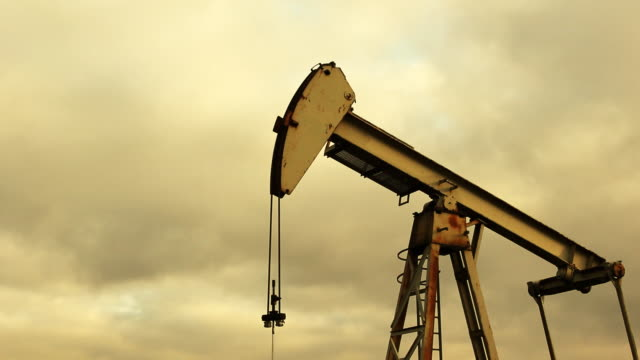 oil pump pumping at sunset - fossil fuel stock videos & royalty-free footage
