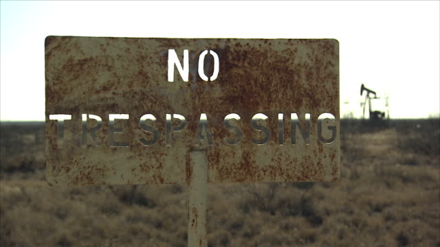 oil pumpjack - no trespassing stock videos & royalty-free footage