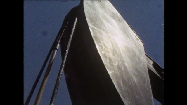 cu of oil pumpjack working in oil field - bbc archive stock-videos und b-roll-filmmaterial