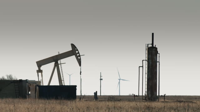 oil pumpjacks and wind turbines - 40 seconds or greater stock videos & royalty-free footage