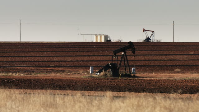 oil pumpjacks near lubbock, texas - industriegerät stock-videos und b-roll-filmmaterial