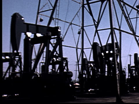 ms, pan, shaky, oil pumps in oil field - prelinger archive stock videos & royalty-free footage
