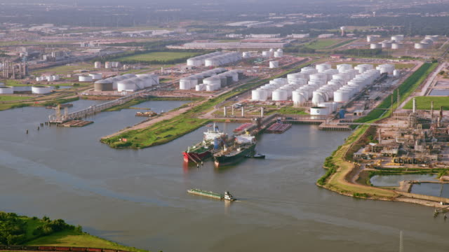 aerial oil refinery along a river in houston, tx - military land vehicle stock videos & royalty-free footage