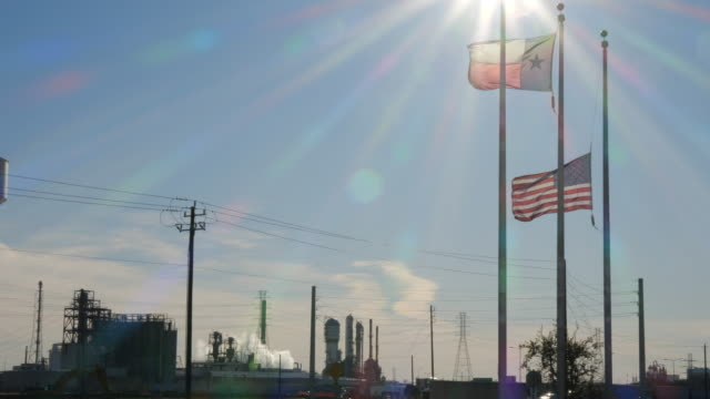oil refinery, american and texas state flag under sunlight - texas stock videos & royalty-free footage