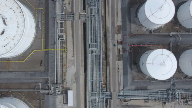 oil refinery and chemical plant with complex pipe in overhead view - gas pipe stock videos and b-roll footage