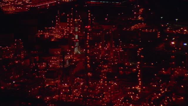 vídeos de stock, filmes e b-roll de aerial oil refinery at night, long beach, california, usa - 2009