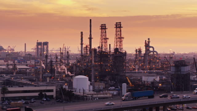 oil refinery at sunset - aerial - port of los angeles stock videos & royalty-free footage