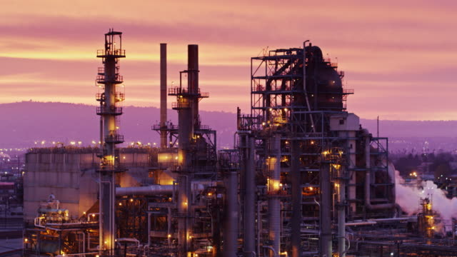 oil refinery at sunset - drone shot - fossil fuel stock videos & royalty-free footage