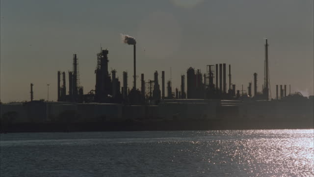 ws, oil refinery at water's edge - 1996 stock videos and b-roll footage