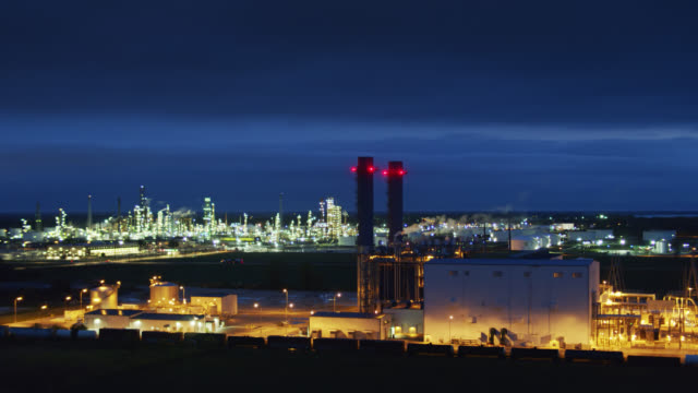 oil refinery before dawn - drone - plant stock videos & royalty-free footage