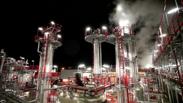 oil refinery by night - water pipe stock videos and b-roll footage