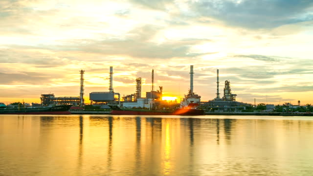 Oil refinery factory at sunrise