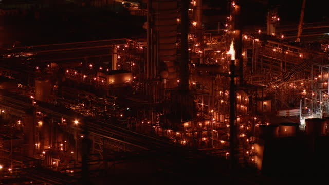 Oil refinery in Carson, California, at night.