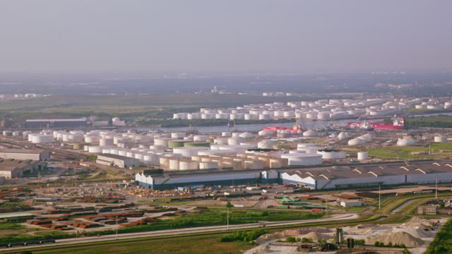 aerial oil refinery in houston, texas - silo stock videos & royalty-free footage
