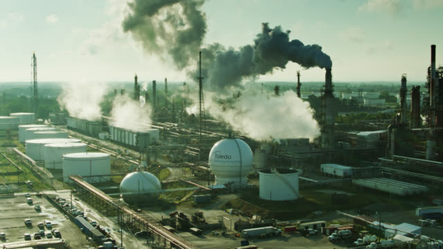 oil refinery in toledo, ohio in morning sunlight - aerial view - oil industry stock videos & royalty-free footage