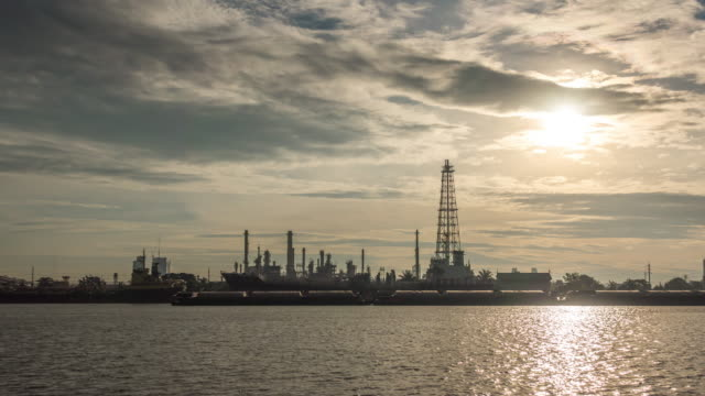 Oil refinery is working at sunrise