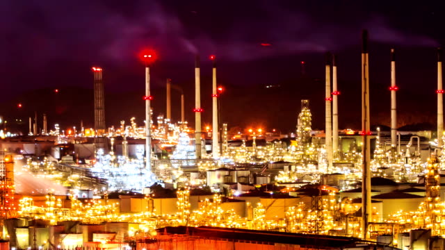 oil refinery plant at twilight night