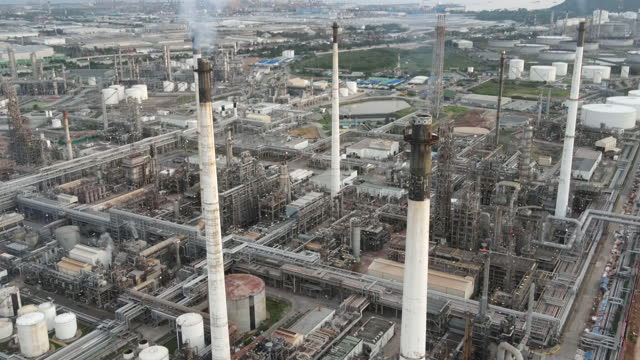 oil refinery plant drone aerial and industrial factory building construction from engineering technology and steel material such as steel structure, metal, valve control, pipe, pipeline for transport oil and gas. - aerial transport building stock videos & royalty-free footage