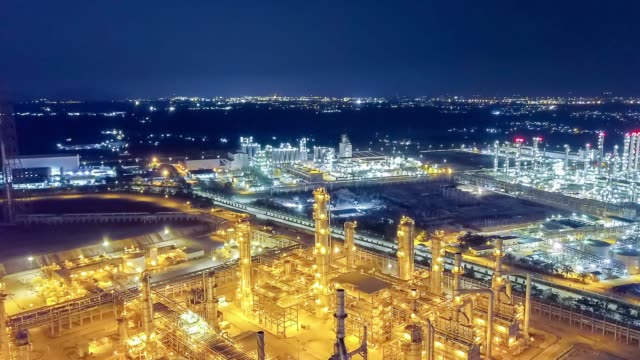 oil refinery plant form industry zone, aerial view oil and gas industrial, refinery factory oil storage tank and pipeline steel at night. - agricultural machinery stock videos & royalty-free footage