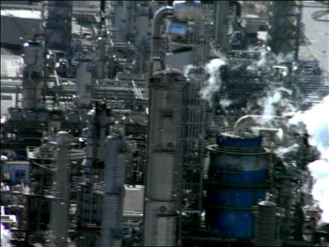 aerial oil refinery plant spewing smoke / el segundo, california - el segundo stock videos and b-roll footage