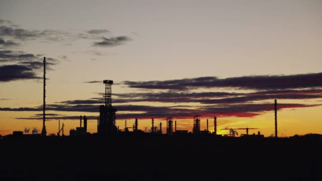 oil refinery. power and energy. time-lapse. sunset time - plant process stock videos & royalty-free footage