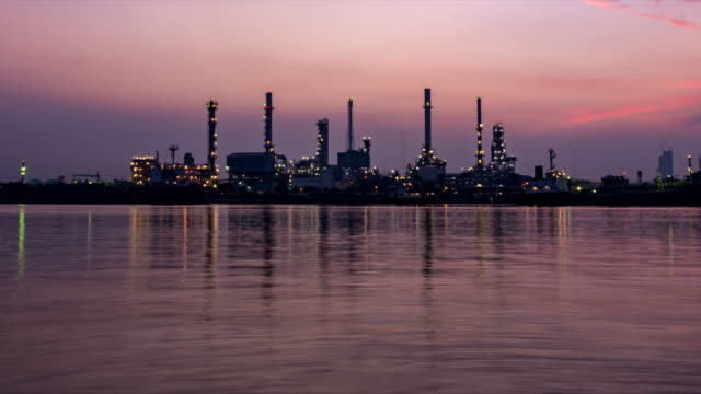 Oil Refinery Station Sunrise time. (Night To Day)