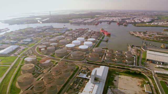 aerial oil refinery storage tanks and cargo ships docked on the river in houston, tx - gulf coast states stock videos & royalty-free footage