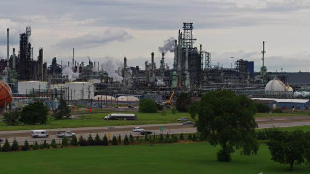 oil refinery with detroit pistons gas tank - drone shot - pipeline stock videos & royalty-free footage