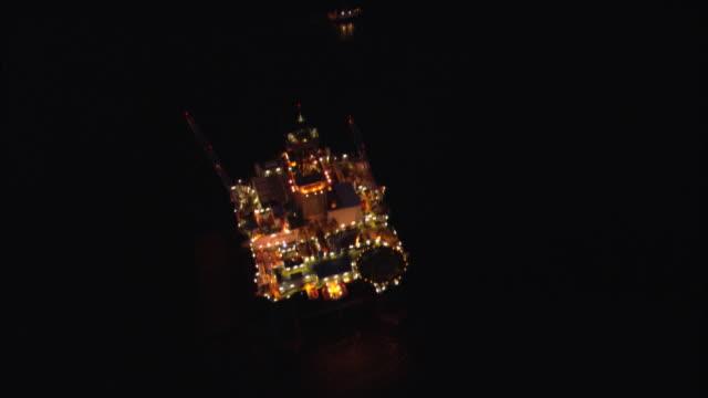 aerial, oil rig illumined at night, halifax, nova scotia, canada - offshore platform stock videos & royalty-free footage
