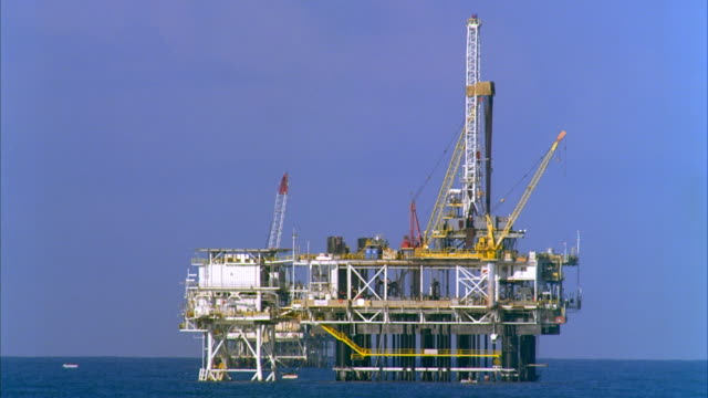 ws oil rig in sea / huntington beach, california, usa - drilling rig stock videos and b-roll footage