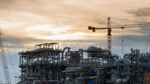 oil rig module construction site work at twilight sunset time - steel stock videos and b-roll footage