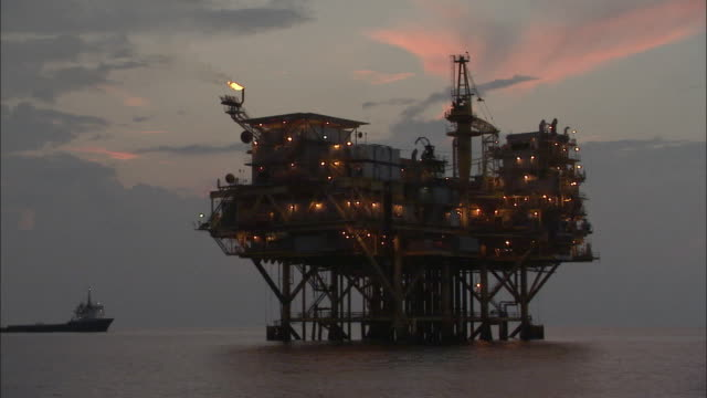 WS, Oil rig on sea at dusk, Louisiana, USA