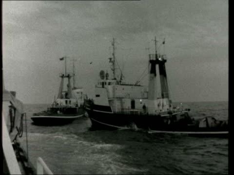 oil rig 'sea quest' moved; oil rig 'sea quest' moved; north sea: day: lv 'sea quest' and tug: tug 'irishman' r-l: row of boats and wake: lv sea... - buoy stock videos & royalty-free footage