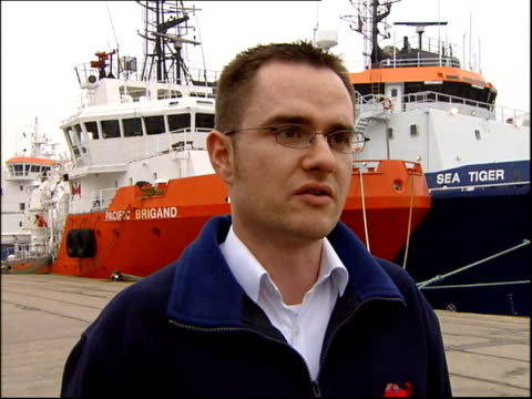 rescue operation called off ext richard coull interview sot - oil rig supply ship stock videos and b-roll footage
