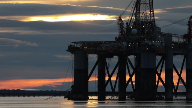 oil rigs anchored in the port of cromarty firth in cromarty scotland uk on tuesday june 23 2020 - horizon over land stock videos & royalty-free footage