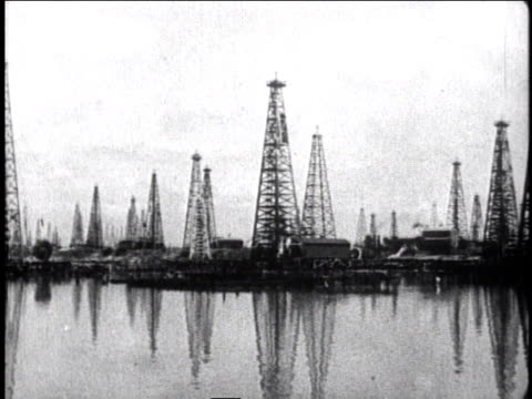 1930 pan oil rigs in oil field / mexico city, mexico - 1930 stock-videos und b-roll-filmmaterial