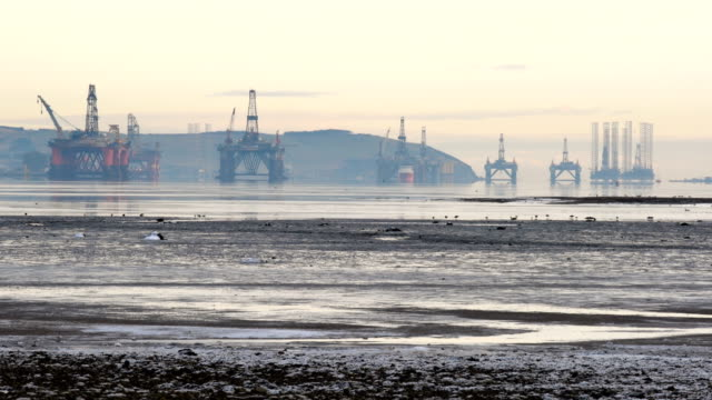 oil rigs weighing thousands of tons are continuing to be stacked up in the cromarty firth on january 12 2018 in invergordon scotland rig platforms... - スコットランド点の映像素材/bロール