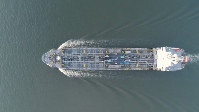 oil ship tanker top speed on the sea to oil refinery for transportation or energy concept background. - above stock videos & royalty-free footage