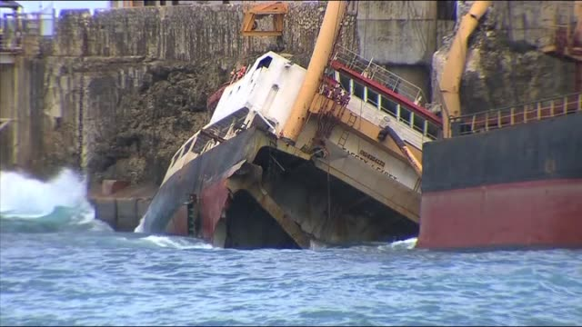 carrier mv tycoon ship wreck at christmas island / stong seas pound carrier against rocks / aerial bulk carrier ship wreck in bay showing fuel oil... - sink stock videos and b-roll footage