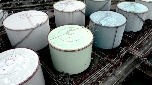 oil storage tank in the port in tsing yi, hong kong - industria petrolifera video stock e b–roll