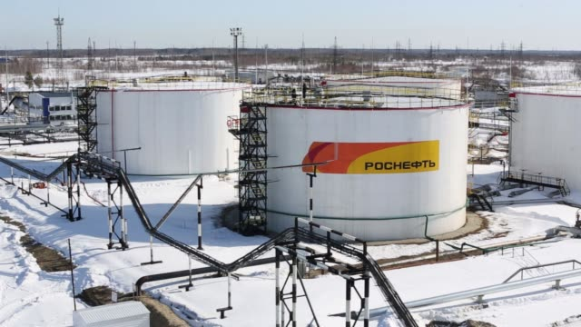 oil storage tanks at a pumping station, operated by rosneft pjsc, in the samotlor oilfield near nizhnevartovsk, russia, on monday, march 20, 2017 - station stock videos & royalty-free footage