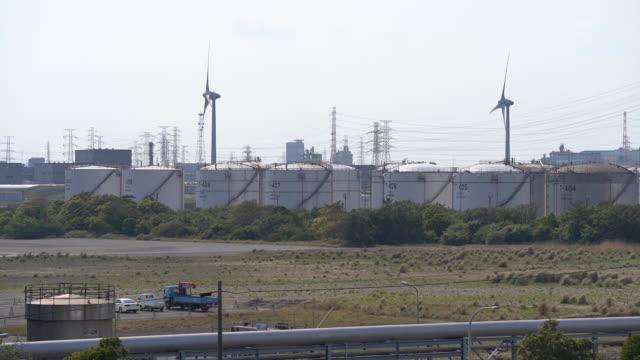 oil storage tanks of kashima oil co., ltd stand in kamisu, ibaraki prefecture, japan, on wednesday, april 29, 2020. people enjoy oritsu beach in... - wind power stock videos & royalty-free footage