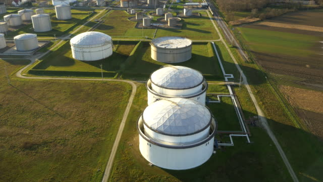 aerial oil storage tanks - storage tank stock videos & royalty-free footage